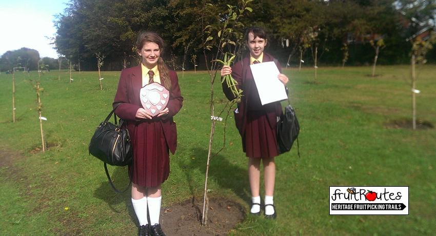 Pupils from Maricourt School in Liverpool present their fruit routes orchard awards